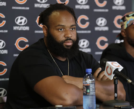 Chicago Bears defensive line Akiem Hicks listens to a question at a news conference during an NFL football training camp in Bourbonnais, Ill., Thursday, July 19, 2018. (AP Photo/Nam Y. Huh)