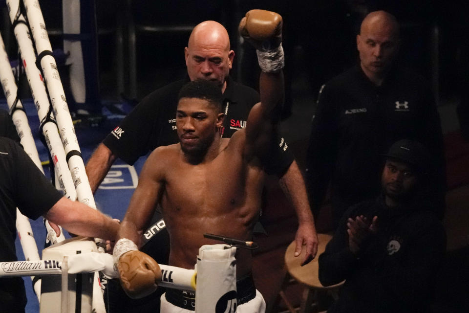 Anthony Joshua of Britain waves to spectators after his defeat to Oleksandr Usyk of Ukraine in their WBA (Super), WBO and IBF boxing title bout at the Tottenham Hotspur Stadium in London, Saturday, Sept. 25, 2021. (AP Photo/Frank Augstein)