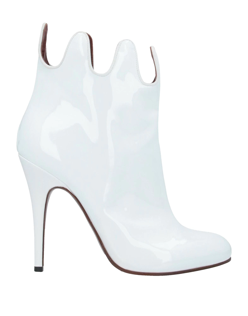 "<br><br><strong>Vivienne Westwood</strong> Ankle boot, $, available at <a href=""https://go.skimresources.com/?id=30283X879131&url=https%3A%2F%2Fwww.yoox.com%2FUS%2F11900053WS%2Fitem%23cod10%3D11900053WS%26sizeId%3D%26sizeName%3D"" rel=""nofollow noopener"" target=""_blank"" data-ylk=""slk:Yoox"" class=""link rapid-noclick-resp"">Yoox</a>"
