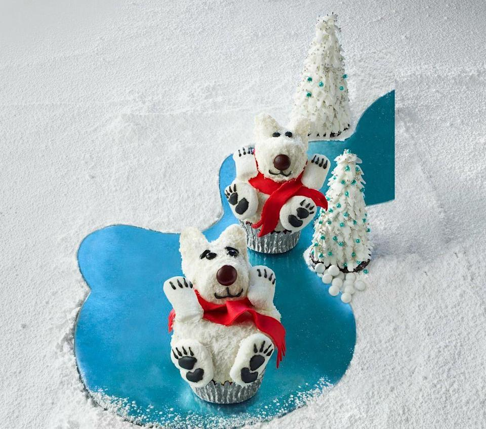 """<p>These cuties are as fun to make as a gingerbread house, but much tastier.</p><p><strong><a href=""""https://www.womansday.com/food-recipes/food-drinks/recipes/a52675/polar-bear-cupcakes/"""" rel=""""nofollow noopener"""" target=""""_blank"""" data-ylk=""""slk:Get the recipe."""" class=""""link rapid-noclick-resp"""">Get the recipe.</a></strong></p>"""