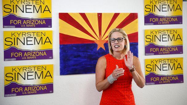 PHOTO: In this Aug. 28, 2018, file photo, Rep. Kyrsten Sinema, D-Ariz., talks to campaign volunteers at a Democratic campaign office in Phoenix. (AP)