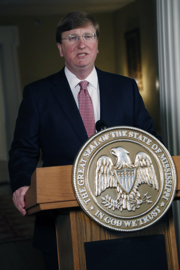 Mississippi Republican Gov. Tate Reeves delivers a televised address prior to signing a bill retiring the last state flag in the United States with the Confederate battle emblem, at the Governor's Mansion in Jackson, Miss., Tuesday, June 30, 2020. The legislation passed both chambers of the Legislature on Sunday. (AP Photo/Rogelio V. Solis, Pool)