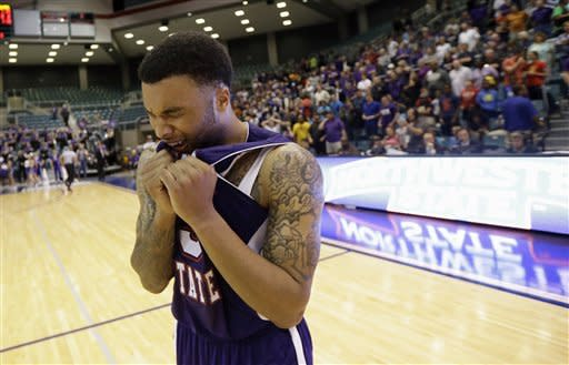 Northwestern State's Shamir Davis (3) celebrates after winning the Southland Conference championship basketball game against Stephen F. Austin Saturday, March 16, 2013, in Katy, Texas. Northwestern State won 68-66. (AP Photo/David J. Phillip)