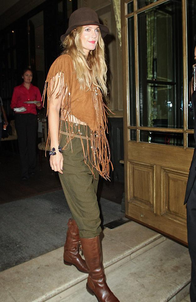 "Not to be outdone, Drew Barrymore showed off her own eccentric sense of style -- in the form of a beaded, fringed poncho -- while out and about in London. <a href=""http://www.infdaily.com"" target=""new"">INFDaily.com</a> - August 21, 2010"