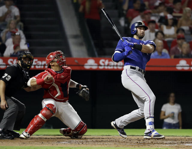 Texas Rangers' Joey Gallo follows through on a 2-RBI double against the Los Angeles Angels during the second inning of a baseball game Monday, Sept. 10, 2018, in Anaheim, Calif. (AP Photo/Marcio Jose Sanchez)