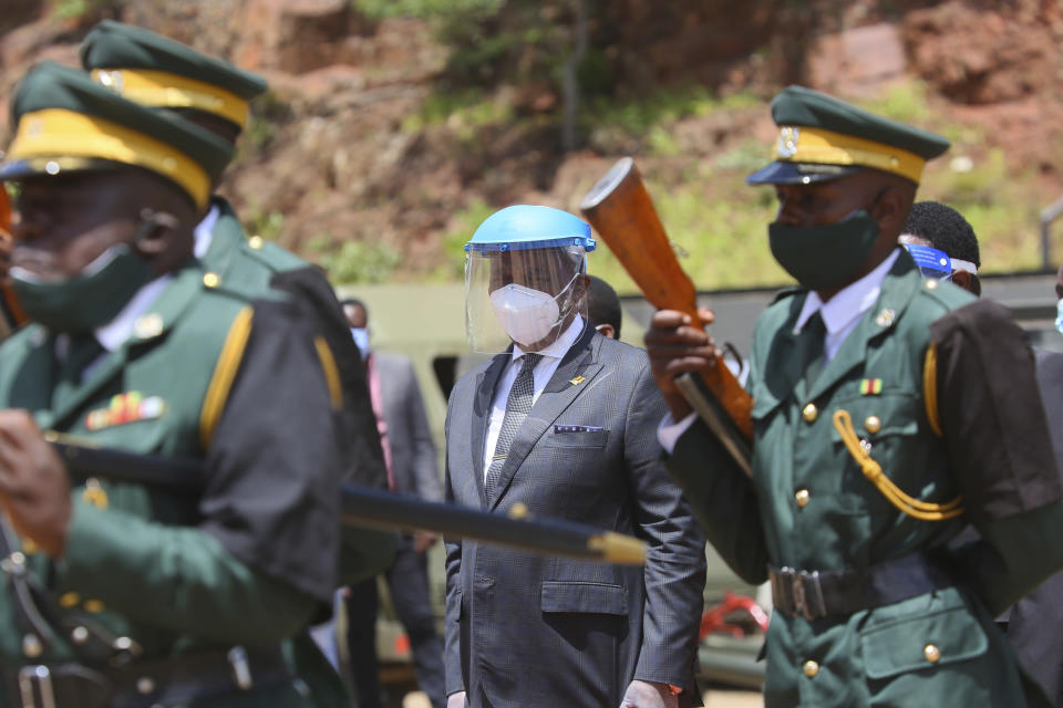 Zimbabwean Deputy President Constantino Chiwenga,centre, arrives to officiate at the burial of three top government officials, at the National Heroes Acre in Harare, Wednesday, Jan. 27, 2021. Zimbabwe on Wednesday buried three top officials who succumbed to COVID-19, in a single ceremony at a shrine reserved almost exclusively for the ruling elite as a virulent second wave of the coronavirus takes a devastating toll on the country. (AP Photo/Tsvangirayi Mukwazhi)