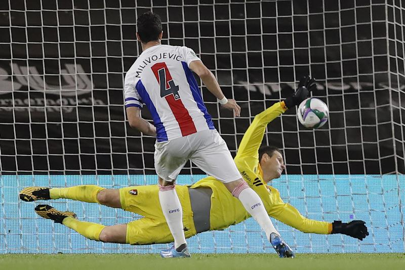 Milivojevic was denied as the Cherries clinched a 11-10 win: POOL/AFP via Getty Images