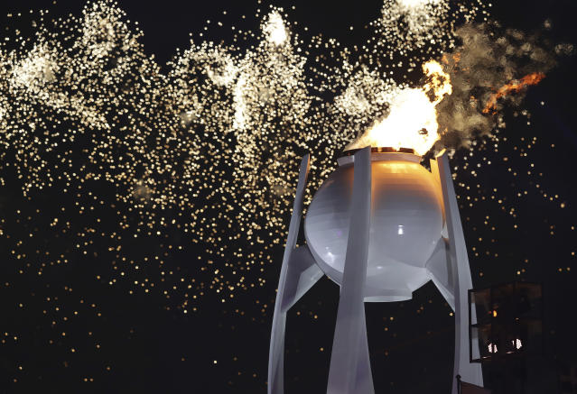 Fireworks explode over the Olympic flame during the opening ceremony of the 2018 Winter Olympics in Pyeongchang, South Korea, Friday, Feb. 9, 2018. (AP Photo/Michael Sohn)