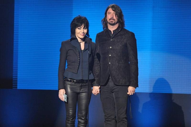 Joan Jett, left, and Dave Grohl present the award for favorite artist - alternative rock at the American Music Awards at the Nokia Theatre L.A. Live on Sunday, Nov. 24, 2013, in Los Angeles. (Photo by John Shearer/Invision/AP)