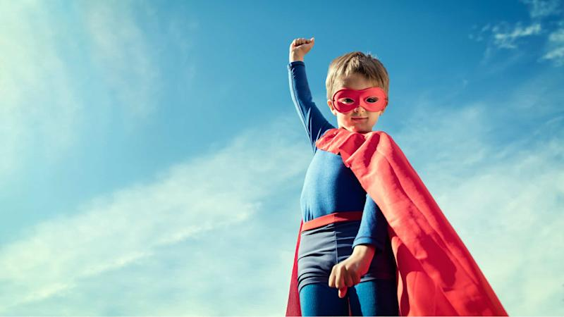 Superhero child reaching higher
