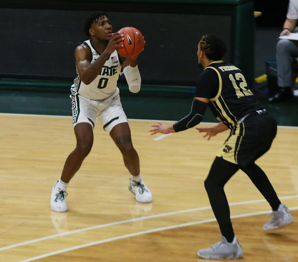 Michigan State's Aaron Henry attempts a 3-pointer in the first half against Western Michigan on Sunday, Dec. 6, 2020, in East, Lansing, Michigan.