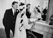 <p>Elizabeth Taylor and Richard Burton share an intimate moment at their first wedding in Montreal, Canada in 1964. They would eventually divorce, remarry, and divorce again.</p>