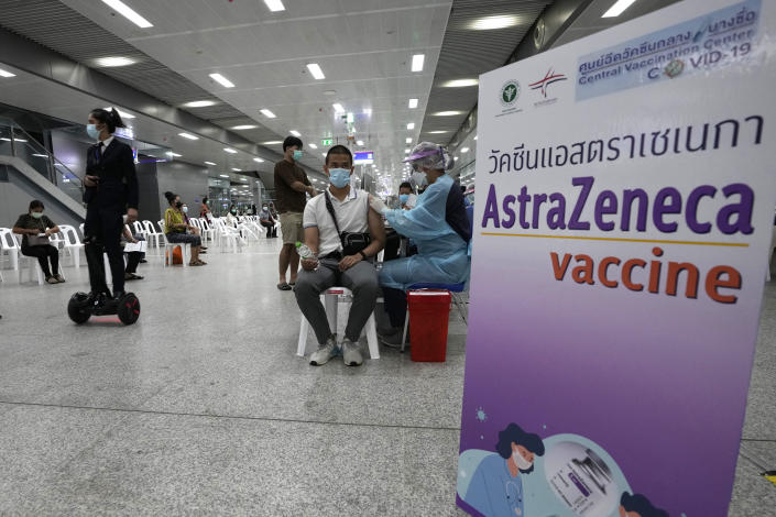 A health worker administer doses of the AstraZeneca COVID-19 vaccine at the Central Vaccination Center in Bangkok, Thailand, Wednesday, July 14, 2021. Health authorities in Thailand said Wednesday they will seek to put limits on the export of locally produced AstraZeneca vaccine, as the country's supplies of COVID-19 vaccines are falling short of what is needed for its own population. (AP Photo/Sakchai Lalit)
