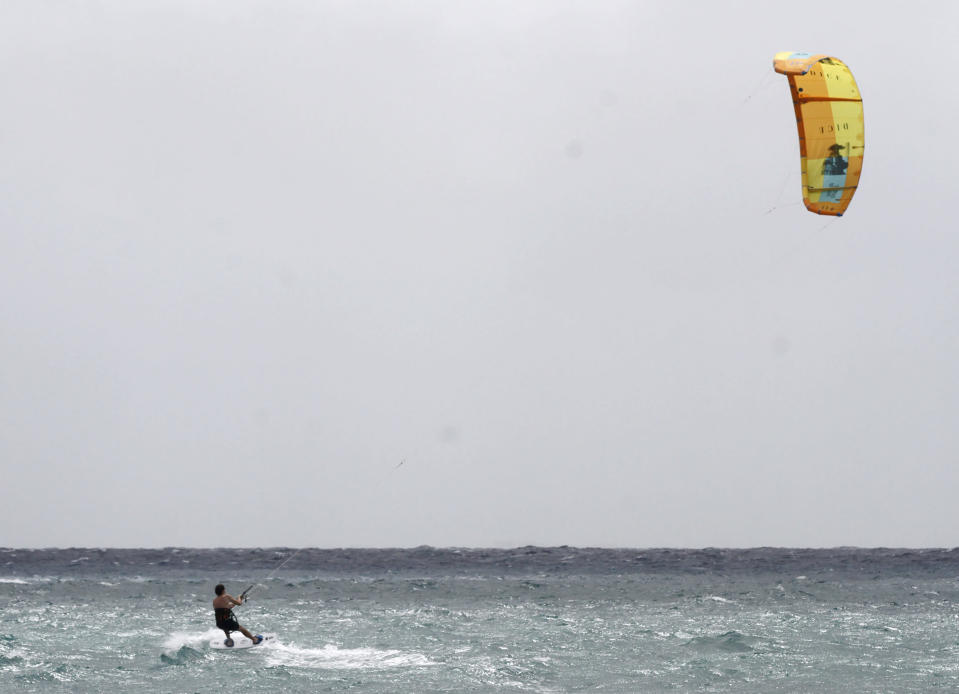 Michael Dixon takes advantage of the rising winds due to the approach of Tropical Storm Zeta as he kite surfs off Playa del Carmen, Mexico, Monday, Oct. 26, 2020. A strengthening Tropical Storm Zeta is expected to become a hurricane Monday as it heads toward the eastern end of Mexico's resort-dotted Yucatan Peninsula and then likely move on for a possible landfall on the central U.S. Gulf Coast at midweek. (AP Photo/Tomas Stargardter)
