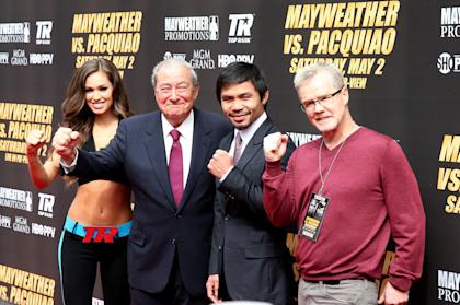(R to L) Trainer Freddie Roach; Manny Pacquiao and promoter Bob Arum pose for the media as they arrive for the press conference Wednesday in Los Angeles. (Photo by Stephen Dunn/Getty Images)
