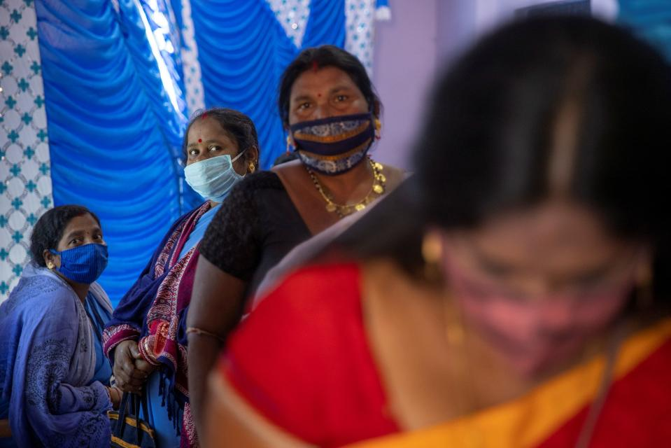 Healthcare workers wait to receive vaccine during one of the world's largest COVID-19 vaccination campaigns at Mathalput Community Health Centre in the remote Koraput district of the eastern state of Odisha, India, January 16, 2021. REUTERS/Danish Siddiqui
