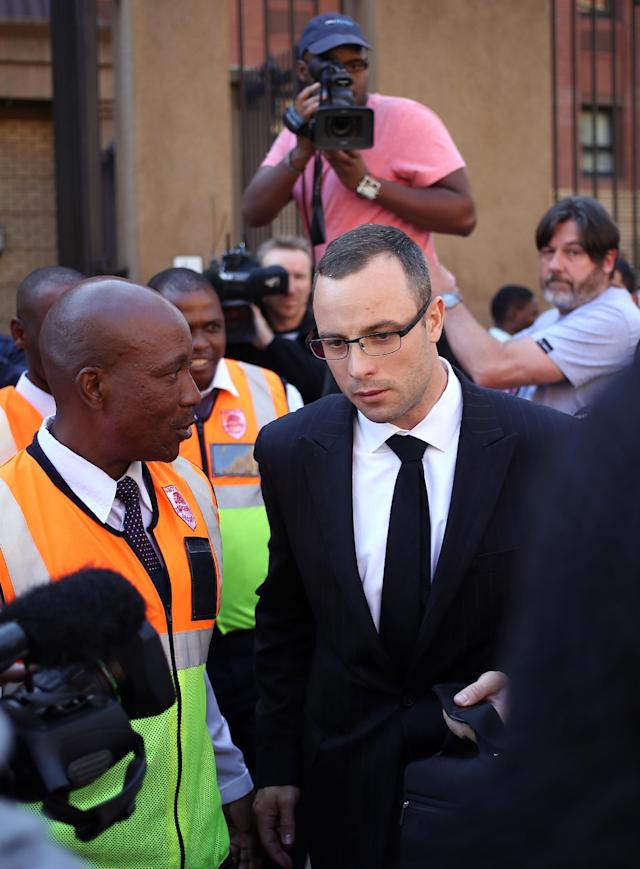 Oscar Pistorius leaves the high court in Pretoria, South Africa, Tuesday, May 13, 2014. Pistorius is charged with murder for the shooting death of his girlfriend, Reeva Steenkamp, on Valentines Day in 2013. (AP Photo/Themba Hadebe)