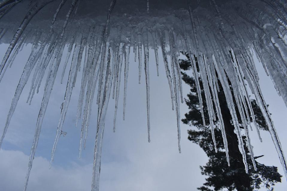 Icicles hanging from a roof top of a hotel in Gulmarg.