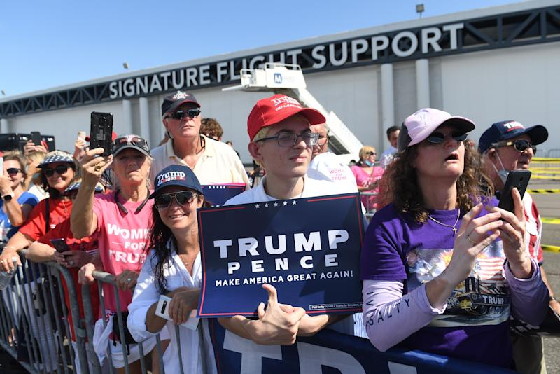 Supporters of US President Donald Trump wait for him to speak during a Campaign Coalitions Event with Florida Sheriffs at Tampa International Airport in Tampa, Florida, July 31, 2020. (Saul Loeb/AFP via Getty Images)