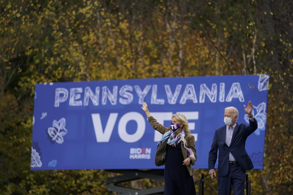 Democratic presidential candidate former Vice President Joe Biden and his wife Jill Biden arrive at a campaign stop at Bucks County Community College, Saturday, Oct. 24, 2020, in Bristol, Pa. (AP Photo/Andrew Harnik)