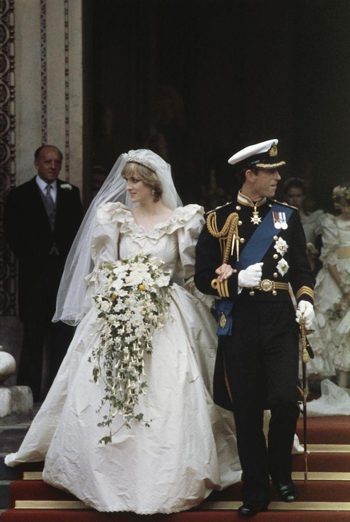 """<p>Princess Diana's wedding dress was the epitome of '80s bridal fashion. But the David and Elizabeth Emanuel dress wasn't without criticism. Some believed the lengthy 25-foot-long train was a tad over the top. Others pointed out the <a href=""""https://www.townandcountrymag.com/the-scene/weddings/g18205746/princess-diana-wedding-dress/"""" rel=""""nofollow noopener"""" target=""""_blank"""" data-ylk=""""slk:wrinkles on the taffeta gown"""" class=""""link rapid-noclick-resp"""">wrinkles on the taffeta gown</a> caused by the carriage ride to St. Paul's Cathedral. </p>"""