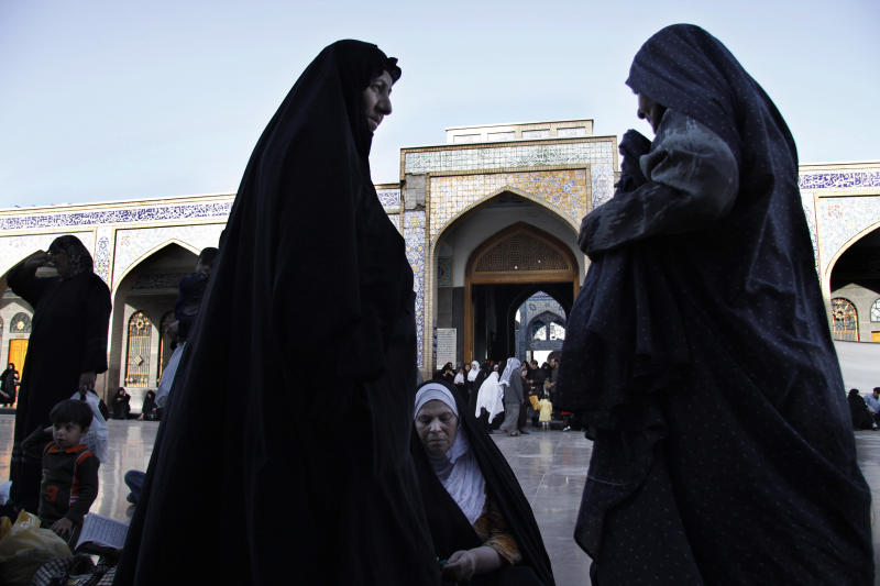 FILE - This April 22, 2009 file photo, shows Iraqi women at the al-Sayda Zeinab shrine in southern Damascus, Syria. Hatreds between Shiites and Sunnis are now more virulent than ever in the Arab world because of Syria's brutal civil war. Hard-line clerics and politicians on both sides have added fuel, depicting the fight as essentially a war of survival for their sect. (AP Photo/Ola Rifai, File)