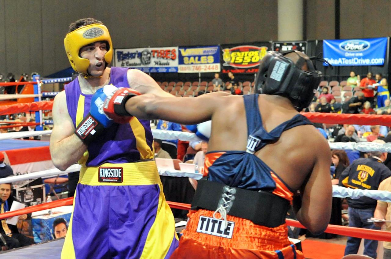 SALT LAKE CITY, UT - MAY 4:  Tamerlan Tsamaev (L) fights Lamar Fenner (R) during the 201-pound division boxing match during the 2009 Golden Gloves National Tournament of Champions May 4, 2009 in Salt Lake City, Utah. After a car chase and shoot out with police, one suspect in the Boston Marathon bombing, Tamerlan Tsarnaev, 26, was shot and killed by police early morning April 19, and a manhunt is underway for his brother and second suspect, 19-year-old Dzhokhar A. Tsarnaev. The two men are suspects in the bombings at the Boston Marathon on April 15, that killed three people and wounded at least 170.  (Photo by Glenn DePriest/Getty Images)