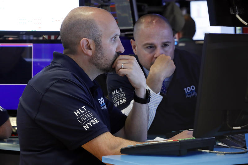 Specialists James Denaro, left, and Mario Picone work on the floor of the New York Stock Exchange, Wednesday, May 29, 2019. Stocks are getting off to a weak start on Wall Street led by drops in technology and health care companies. (AP Photo/Richard Drew)