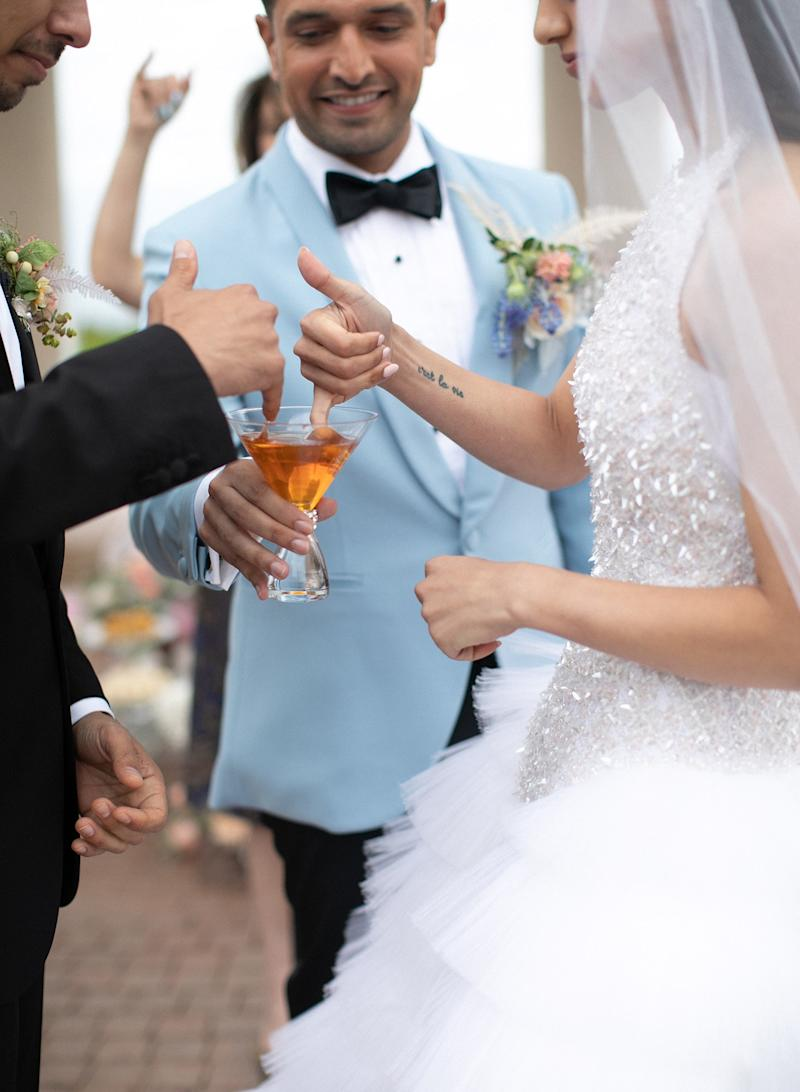 My man of honor, David, bringing us honey to dip our fingers into and feed each other, to represent always being sweet and kind to each other. Traditionally, the bride is supposed to bite the finger of the groom when he feeds her the honey, to tease him that his wife is sweet and feisty!