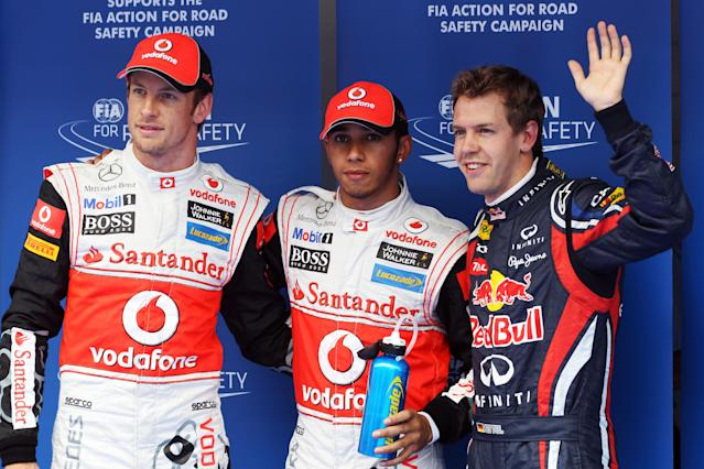 YEONGAM-GUN, SOUTH KOREA - OCTOBER 15: Pole sitter Lewis Hamilton (C) of Great Britain and McLaren is joined by second placed Sebastian Vettel (R) of Germany and Red Bull Racing and third placed Jenson Button (L) of Great Britain and McLaren in parc ferme following qualifying for the Korean Formula One Grand Prix at the Korea International Circuit on October 15, 2011 in Yeongam-gun, South Korea. (Photo by Clive Rose/Getty Images)