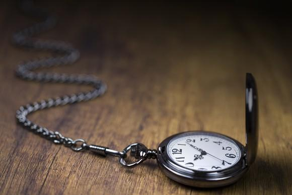 Pocket watch opened on a table.