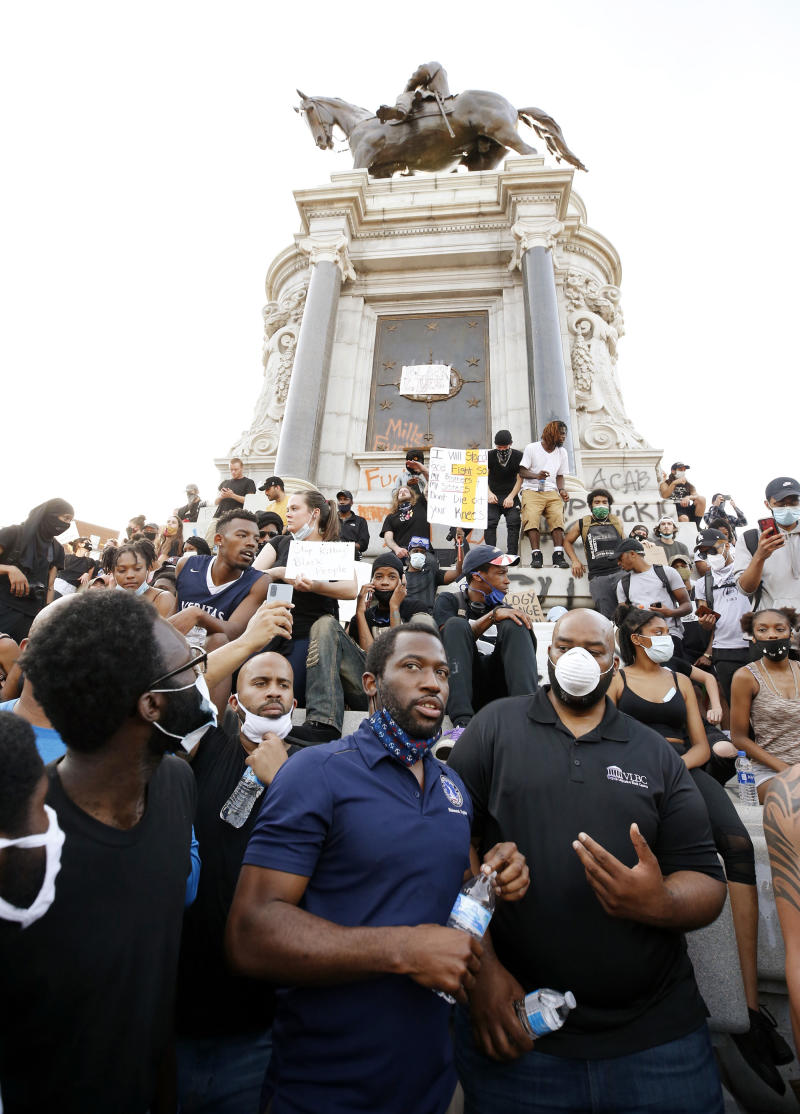 Mayor Stoney with demonstrators at the base of the Richmond monument to Robert E. Lee on June 2.