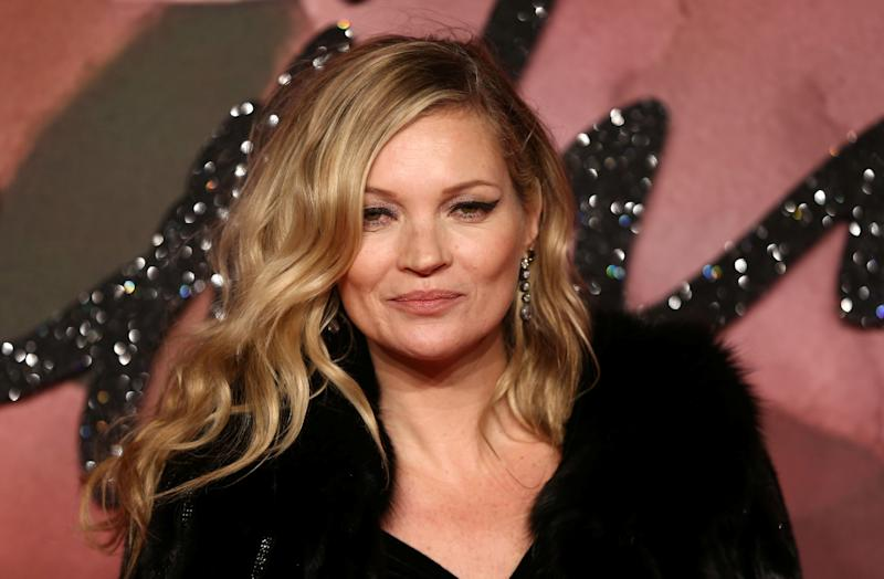 Model Kate Moss poses for photographers at the Fashion Awards 2016 in London, Britain December 5, 2016. REUTERS/Neil Hall