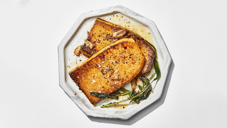 "Applying the classic steakhouse butter-basting technique to slabs of butternut squash turns it into a hearty vegetarian main. <a href=""https://www.bonappetit.com/recipe/butternut-squash-steaks-with-brown-butter-sage-sauce?mbid=synd_yahoo_rss"" rel=""nofollow noopener"" target=""_blank"" data-ylk=""slk:See recipe."" class=""link rapid-noclick-resp"">See recipe.</a>"