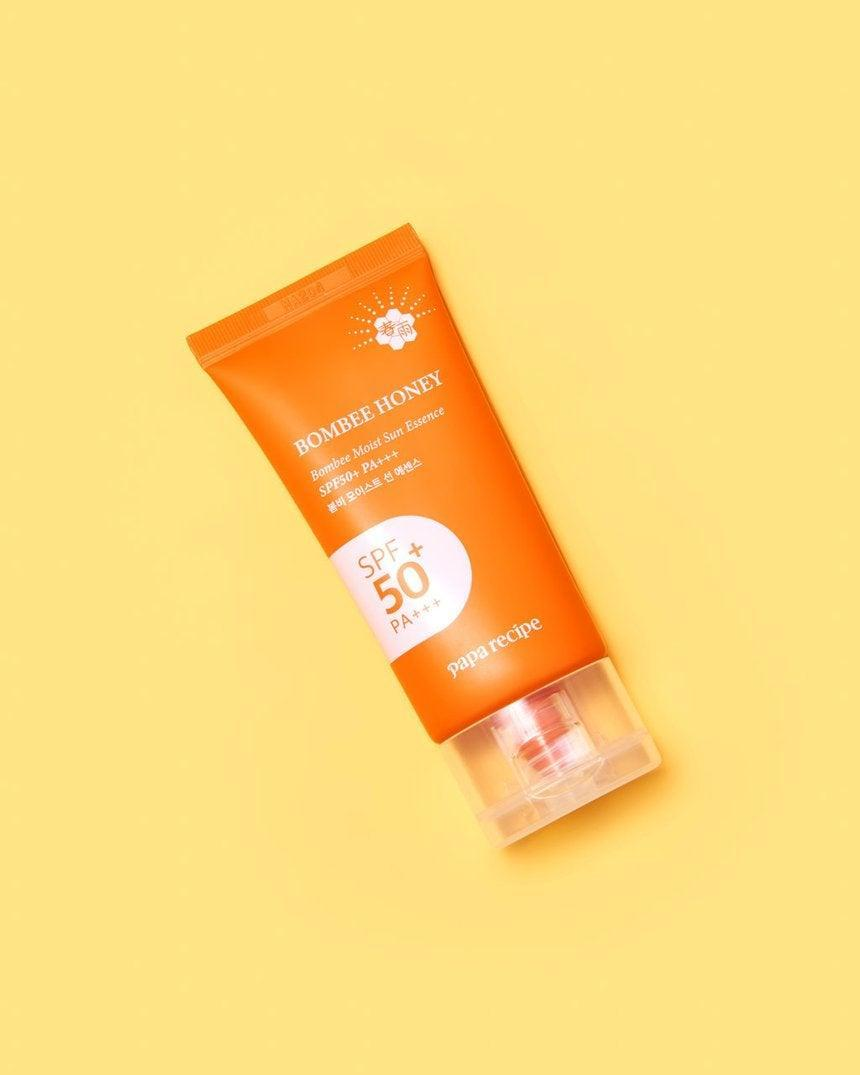 """<h3>Bombee Moist Sun Essence SPF 50+ PA+++</h3> <br>This bestselling Soko Glam gem is made with botanical ingredients like honey, propolis, and royal jelly extract to bestow a radiant, glowing complexion while shielding you from UV rays.<br><br><strong>Fan-Following Says</strong>: """"I love this sunblock. It gives me a glow without being greasy or leaves a white cast like so many others. I have olive skin tone and hyperpigmentation, so the brightening glow this gives me helps conceal my dark spots. Works great under makeup and does not make me break out or feel like I have spackle on my face.""""<br><br><strong>Papa Recipe</strong> Bombee Moist Sun Essence SPF 50+ PA+++, $, available at <a href=""""https://go.skimresources.com/?id=30283X879131&url=https%3A%2F%2Ffave.co%2F30JUyqk"""" rel=""""nofollow noopener"""" target=""""_blank"""" data-ylk=""""slk:Soko Glam"""" class=""""link rapid-noclick-resp"""">Soko Glam</a><br><br><br>"""