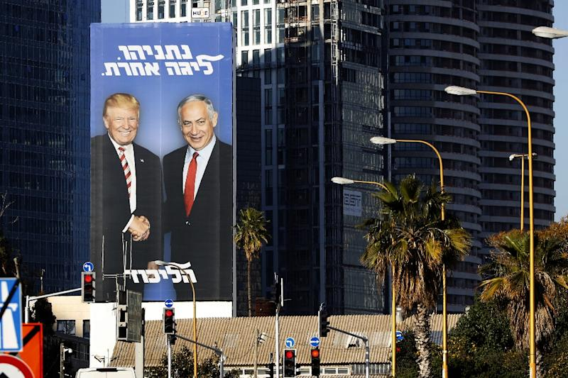 "A giant election billboard of Israeli Prime Minister Benjamin Netanyahu and US President Donald Trump, with a slogan in Hebrew: ""Netanyahu, in another league"". (AFP Photo/JACK GUEZ)"