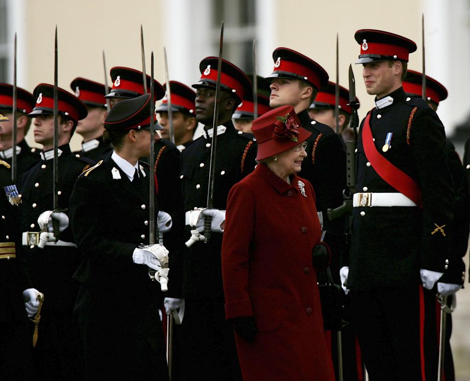 SANDHURST, ENGLAND - DECEMBER 15:  HRH Prince William (R with red sash) is inspected by his grandmother HM Queen Elizabeth II as he takes part in The Sovereigns Parade at The Royal Military Academy Sandhurst on December 15, 2006 in Sandhurst, England.There were 446 Officer Cadets in the parade of which 227 were passing out and 14 different countries armed forces were represented.  (Photo by Julian Herbert/Getty Images)