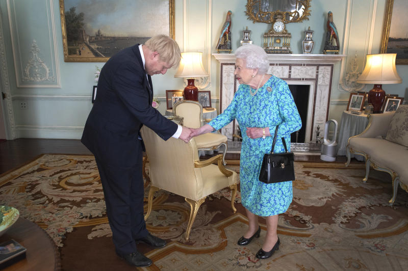 Queen Elizabeth II welcomes newly elected leader of the Conservative party, Boris Johnson during an audience where she invited him to become Prime Minister and form a new government in Buckingham Palace on July 24, 2019 in London, Englan