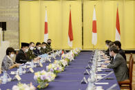 Indonesian Defense Minister Prabowo Subianto, second from left, Indonesian Foreign Minister Retno Marsudi, left, hold a talk with Toshimitsu Motegi, Japan's foreign minister, right, and Japanese Defense Minister Kishi Nobuo, at the start of the two-plus-two Foreign and Defense Ministers meeting between Japan and Indonesia Tuesday, March 30, 2021 at the Iikura Guesthouse of the Foreign Ministry in Tokyo, Japan.(David Mareuil/Pool Photo via AP)