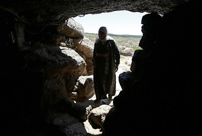 <p>A member of the al-Hawamdeh family enters the cave they use as their home, on the outskirts of the West Bank village of Mufagra, in Yatta village, 80 km to the south of the city of Hebron, April 6, 2017. Residents allegedly received orders from the Israeli army to prevent them from building houses or roads in the area. According to the elders, the family was living in this area for about 200 to 300 years and their livelihood depends on livestock. (Photo: Abed Al Hashlamoun/EPA) </p>