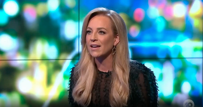 Carrie Bickmore in a black top on The Project