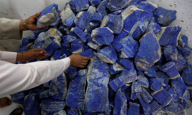Men sort lapis lazuli inside a shop in Kabul, Afghanistan
