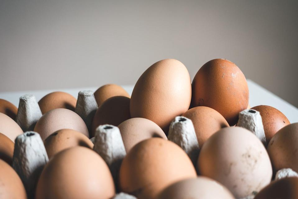 """<p>Not only are eggs loaded in high-quality protein and important nutrients, but those breakfast favorites are a <a href=""""https://pubmed.ncbi.nlm.nih.gov/21269547/"""" class=""""link rapid-noclick-resp"""" rel=""""nofollow noopener"""" target=""""_blank"""" data-ylk=""""slk:natural source of tryptophan"""">natural source of tryptophan</a>, an amino acid that plays a role in creating serotonin, a chemical that <a href=""""https://www.ncbi.nlm.nih.gov/pmc/articles/PMC3218476/"""" class=""""link rapid-noclick-resp"""" rel=""""nofollow noopener"""" target=""""_blank"""" data-ylk=""""slk:helps regulate sleep cycles"""">helps regulate sleep cycles</a>.</p> <p>Although the results are based on adult subjects, data published in British Journal of Nutrition suggests <a href=""""https://www.cambridge.org/core/journals/british-journal-of-nutrition/article/chronic-treatment-with-a-tryptophanrich-protein-hydrolysate-improves-emotional-processing-mental-energy-levels-and-reaction-time-in-middleaged-women/AB54DC8C47AF5C589B87EDD30B382386"""" class=""""link rapid-noclick-resp"""" rel=""""nofollow noopener"""" target=""""_blank"""" data-ylk=""""slk:improvements in sleep after 19 days of tryptophan-rich egg-white protein hydrolysate was consumed"""">improvements in sleep after 19 days of tryptophan-rich egg-white protein hydrolysate was consumed</a> versus those who did not eat the egg whites.</p>"""
