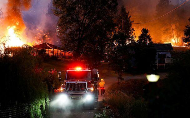 PHOTO: A firefighter guides a firetruck down a driveway to protect homes threatened by the flames at the River Fire, a wildfire near the Placer County town of Grass Valley, Calif., Aug. 4, 2021. (Fred Greaves/Reuters)