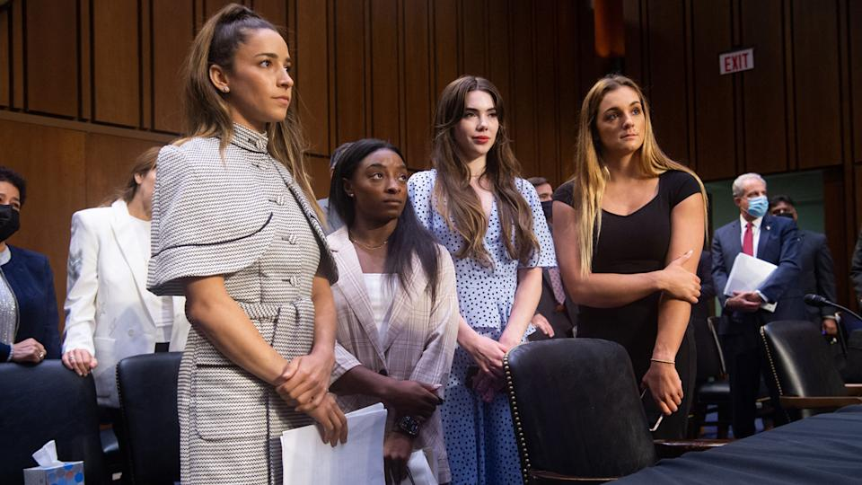 Gymnasts Aly Raisman, Simone Biles, McKayla Maroney and Maggie Nichols leave after testifying on Capitol Hill Wednesday. (Photo by Saul Loeb/AFP via Getty Images)