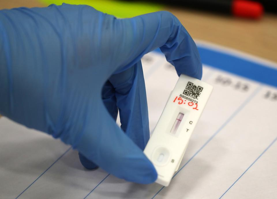 People carry out asymptomatic testing using lateral flow antigen at a test centre at Edinburgh University ahead of students being allowed to travel home for the Christmas holidays.
