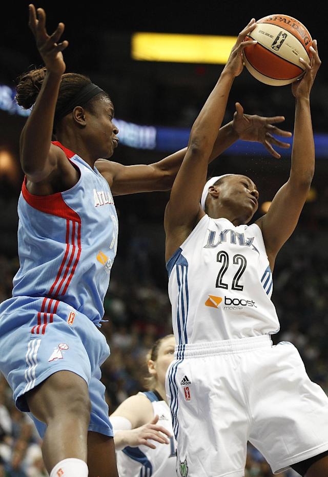Minnesota Lynx guard Monica Wright (22) grabs a rebound against Atlanta Dream forward Aneika Henry (13) during Game 1 of the WNBA basketball Finals, Sunday, Oct. 6, 2013, in Minneapolis. (AP Photo/Stacy Bengs)