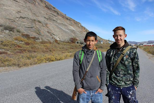 Knud Lyberth, left, with his brother, Enos, on the road that cuts through Kangerlussuaq.