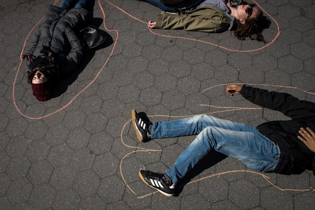 <p>Student activists participate in a 'die-in' to protest gun violence at Washington Square Park, near the campus of New York University, April 20, 2018 in New York City. (Photo: Drew Angerer/Getty Images) </p>