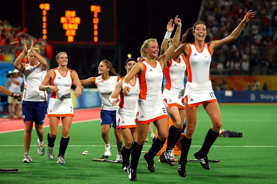 BEIJING - AUGUST 22: Naomi Van As #18 and Sophie Polkamp #21 of the Netherlands celebrate after their 2-0 victory over China in the women's gold medal hockey match at the Olympic Green Hockey Field on Day 14 of the Beijing 2008 Olympic Games on August 22, 2008 in Beijing, China. (Photo by Lars Baron/Bongarts/Getty Images)